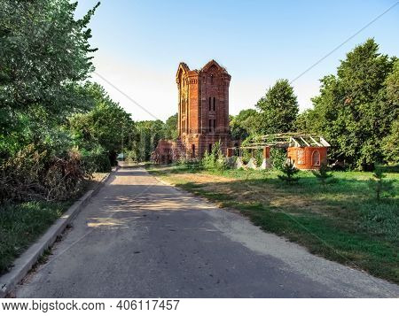 Ruined Tower Of The Former City Baths In Putyvl Outdoors Among Green Thickets On A Sunny Summer Day