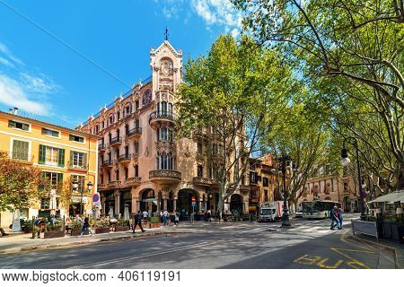 PALMA, SPAIN - APRIL 11, 2019: People walking on the street in the city center of Palma - aka Palma de Mallorca, capital and largest city of he Balearic Islands in Spain, popular tourist destination.