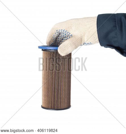 An Auto Mechanic Holds An Old Dirty Fuel Filter In His Hand. Fuel Filter Replacement Concept, Low-qu