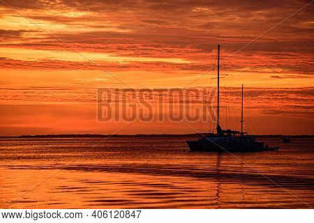 Travel Yachting Cruise. Sailboats At Sunset. Ocean Yacht Sailing Along Water
