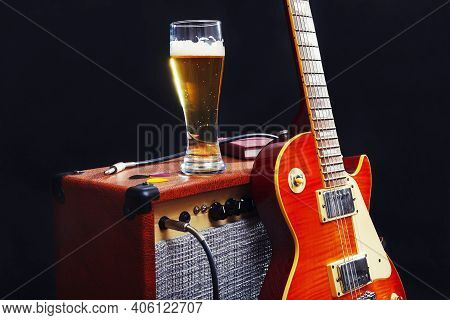 Tube Combo Amplifier For Guitar With Guitar, Glass Of Beer And Notepad On The Black Background.