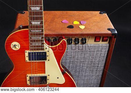 Guitar Combo Amplifier With Honey Sunburst Guitar On The Black Background.