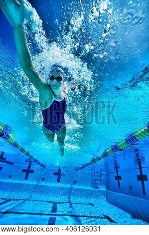 Underwater shot of woman swimming in pool