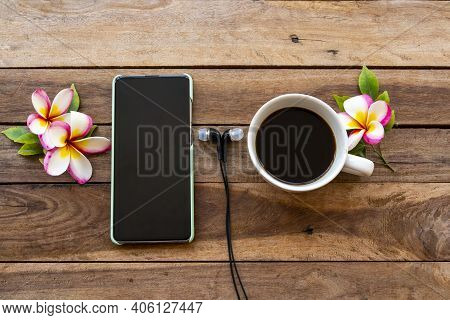 Mobile Phone ,hot Coffee And Flowers Frangipani Of Lifestyle Relax Arrangement Flat Lay Style On Bac