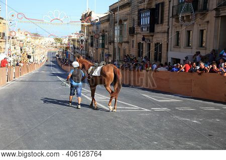 Victoria, Malta - August 15, 2019: Traditional Maltese Horse Racing At Republic Street During Feast