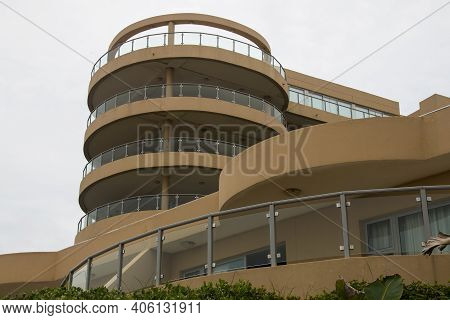 Upward View Of Circular Residential Building Against Cloudy Sky