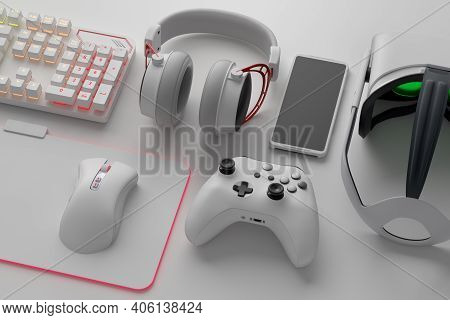 Top View Of Gamer Workspace And Gear Like Mouse, Keyboard, Joystick, Headset, Vr Headset On White Ta