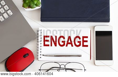 Engage Text On Notepad,pen, Office Tools On The White Background. Business