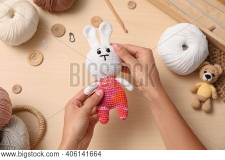 Woman With Crocheted Toys At Wooden Table, Top View. Engaging Hobby