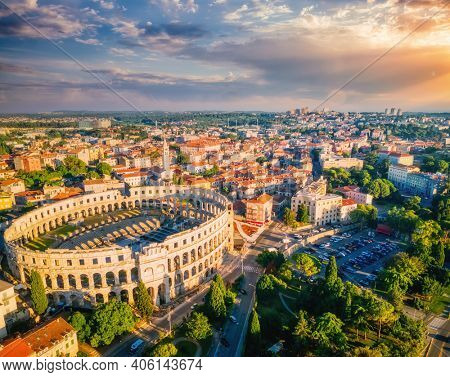 Splendid view at famous european city of Pula and arena of roman time. Location place of Istria county, Croatia, Europe. Wonders of the world. UNESCO world heritage site. Discover the beauty of earth.
