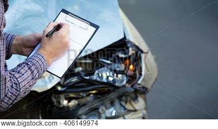 Male Hands With Paper Mock Up Auto Insurance Blank Against Destroyed Car In Crash Traffic Accident.