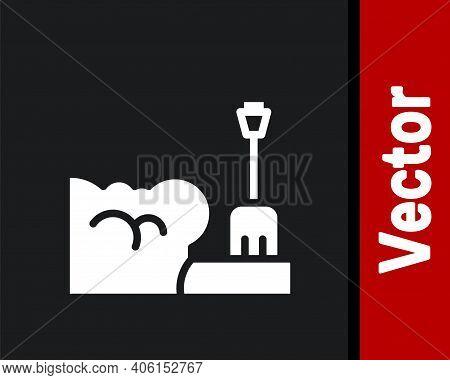 White Shovel In Snowdrift Icon Isolated On Black Background. Vector