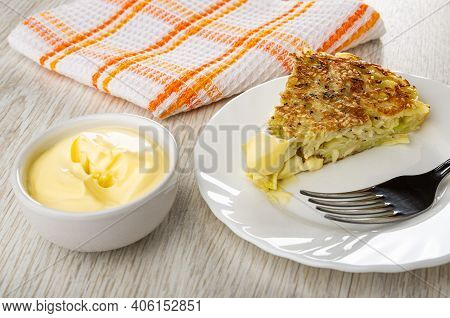 Checkered Napkin, Bowl With Mayonnaise, Piece Of Cabbage Flatbread With Mayonnaise, Fork In White Pl