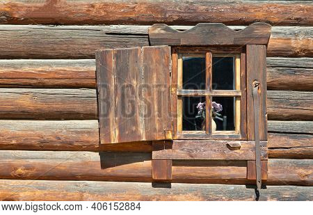 Casement Window On An Old Log Wall. Window Of The Village Hut