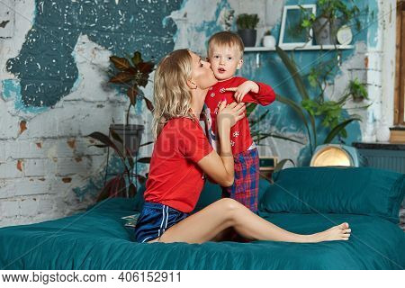 Young Mother Plays And Hugs Her Son. Day Off At Home, A Smile On Your Face. Growing Up A Child