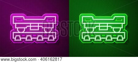 Glowing Neon Line Cargo Train Wagon Icon Isolated On Purple And Green Background. Freight Car. Railr