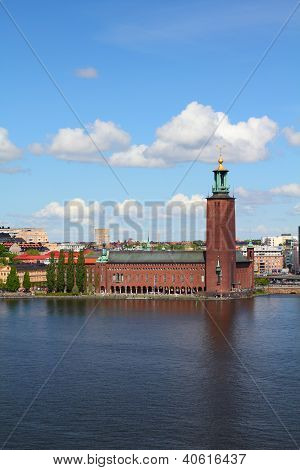 Stockholm Sweden. Skyline of Kungsholmen island with famous City Hall (Stadshuset) seen from Sodermalm island across Riddarfjarden channel. poster