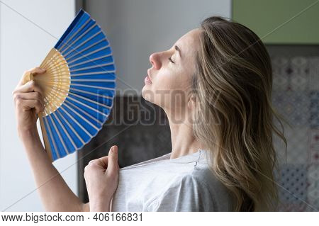 Side View Caucasian Tired Overheated Woman In T-shirt Using Wave Fan Suffer From Heat Sweating, Cool