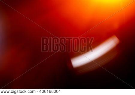 Lens Flare. Defocused Radiance. Light Flecks. Sun Beams. Red Orange Blur Rays Digital Glints On Dark