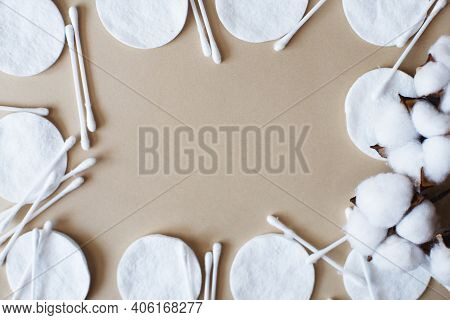 Fluffy Cotton Flower Cotton Pads And Cotton Swabs On A Beige Background With Copy Space. Hygienic Di