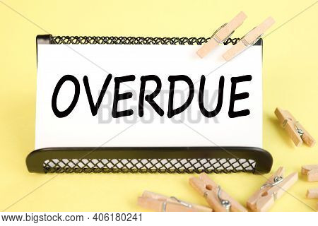 Overdue, Text On White Paper On Yellow Background