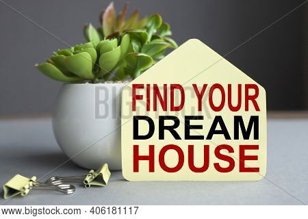Find Your Dream House, Text On Yellow Sticker In The Form Of A House On A Gray Background