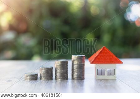 Orange House And Coin Ladder Natural Background Home Plan Ideas, Saving Money, Investing In Real Est
