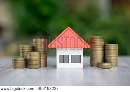 Orange Roof Model House In The Middle Of A Pile Of Coins Real Estate Concept Home Loan Mortgage Futu