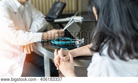 Menopause Woman, Stressful Patient Consulting With Doctor Or Psychiatrist Counselor Who Diagnostic E