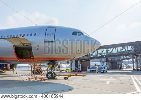 Preflight Service, Aircraft Maintenance, Baggage Is Loading Into The Luggage Compartment Of The Airc