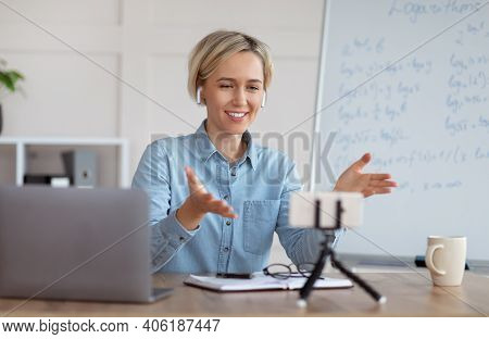Distance Learning And Online Tutoring. Confident Female Teacher Giving Online Math Class, Explaining