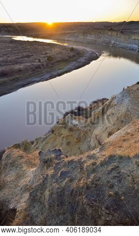 View Of The Winding River From The Mountain In The Evening At Sunset. North Dakota