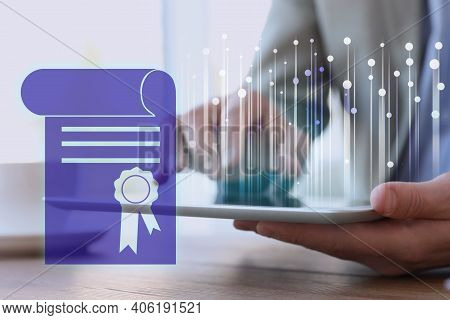 Online Learning Concept. Diploma On Foreground And Man Using Tablet, Closeup
