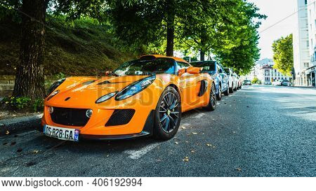 BAYONNE, FRANCE - CIRCA AUGUST 2020: An orange Lotus Exige S parked in the street.