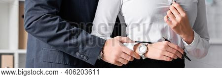 Cropped View Of Businessman Touching Hand Of Secretary While Seducing Her In Office, Banner.