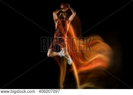 Slam Dunk. Young Arabian Muscular Basketball Player In Action, Motion Isolated On Black Background I