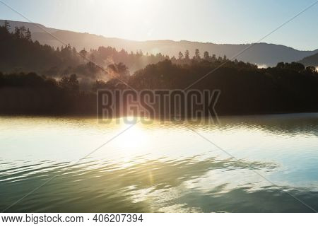 Sunrise scene on beautiful serene lake. Beautiful natural background