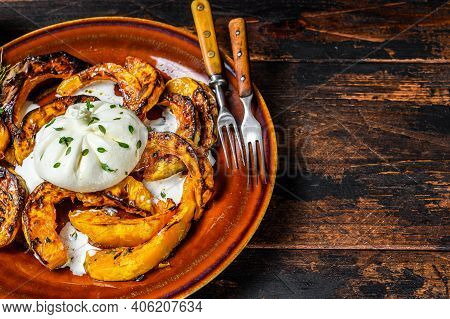 Cheese Burrata Mozzarella With Baked Pumpkin. Dark Wooden Background. Top View. Copy Space