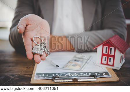 Salesperson Holding House Keys Concept, House Keys For New House, New House Purchase
