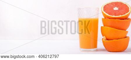 Blood Orange Juice Freshly Squeezed In The Drinking Glass With Pulp On The White Table. Wide Banner