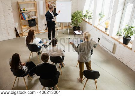 Male Speaker Giving Presentation In Hall At University Workshop. Audience Or Conference Hall. High A