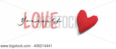 Love Yourself Message With A Red Heart Cushion - Flat Lay