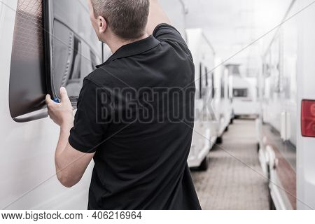 Caucasian Rv Travel Trailers Specialist In His 40s Performing Windows Seals Check. Recreational Vehi