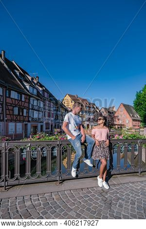Beautiful View Of Colorful Romantic City Colmar, France, Alsace . Europe Couple Mid Age Men And Woma