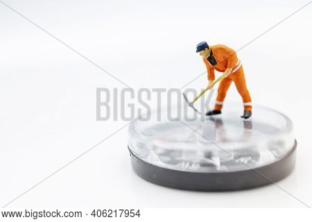 Miniature Worker Digging On Compass. Concept Of Finding Direction And Opportunity.
