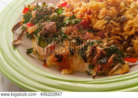 Stuffed Cajun Hasselback Chicken With Spicy Pepper Jack Cheese And Side Of Spanish Pigeon Pea Rice
