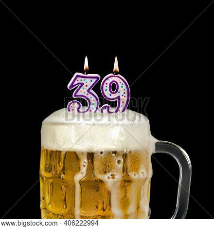 Number 39 Candle In Beer Mug For Birthday Celebration Isolated On Black