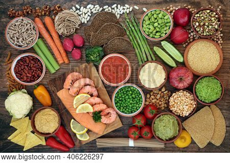 Diabetic health food low on glycemic index with foods high in protein, omega 3, antioxidants, fibre, vitamins, minerals and anthocyanins. All foods below 55 on GI index. Health care concept. Top view.