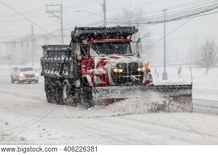 NORWALK, CT, USA -FEBRUARY 1, 2021:  Snow plow truck  during snow storm  day on Connecticut Ave.