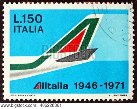 Italy - Circa 1971: A Stamp Printed In Italy Shows Tail Of B747 In Shape Of A, Italian Airlines Foun